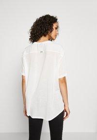 G-Star - WEIR UTILITY LOOSE R-NECK - Camiseta estampada - milk - 2