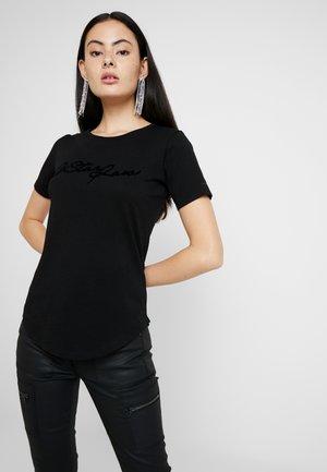 GRAPHIC 4 OPTIC SLIM R T WMN S\S - T-shirt med print - dk black