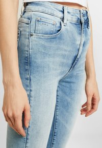 G-Star - 3301 HIGH FLARE - Flared Jeans - sun faded blue - 3