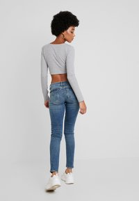 G-Star - MIDGE ZIP MID SKINNY WMN - Jeans Skinny Fit - lt vintage aged destroy - 2