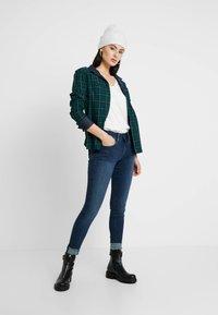 G-Star - LYNN MID SUPER SKINNY  - Jeans Skinny Fit - worn in naval - 1