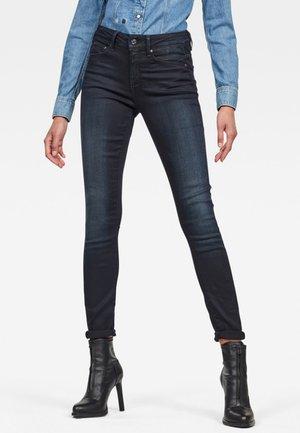 HIGH SKINNY - Jeans Skinny Fit - dark-blue denim