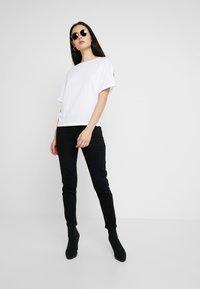 G-Star - JOCI 3D MID SLIM WMN - Slim fit jeans - jet black - 1