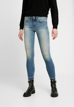 MID SKINNY RIPPED ANKLE - Jeans Skinny Fit - antic faded ripped marine