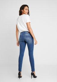 G-Star - 3301 MID SKINNY - Jeans Skinny Fit - sun faded blue - 2