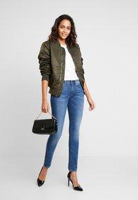 G-Star - 3301 MID SKINNY - Jeans Skinny Fit - sun faded blue - 1