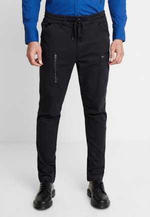 POWEL SLIM TRAINER - Slim fit jeans - dark black