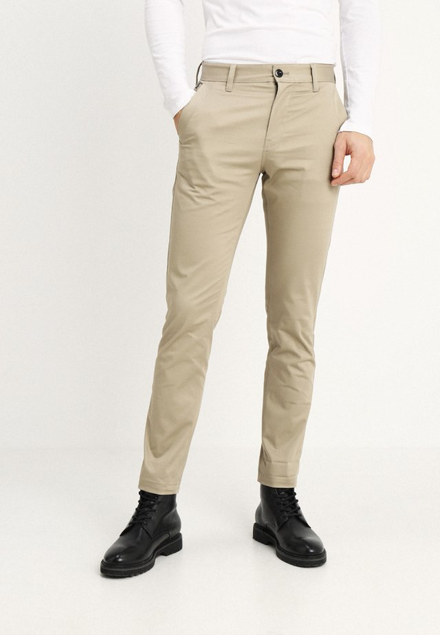 BRONSON - Pantalones chinos - dune