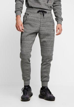 SLIM TAPERED SW PANT - Spodnie treningowe - black heather