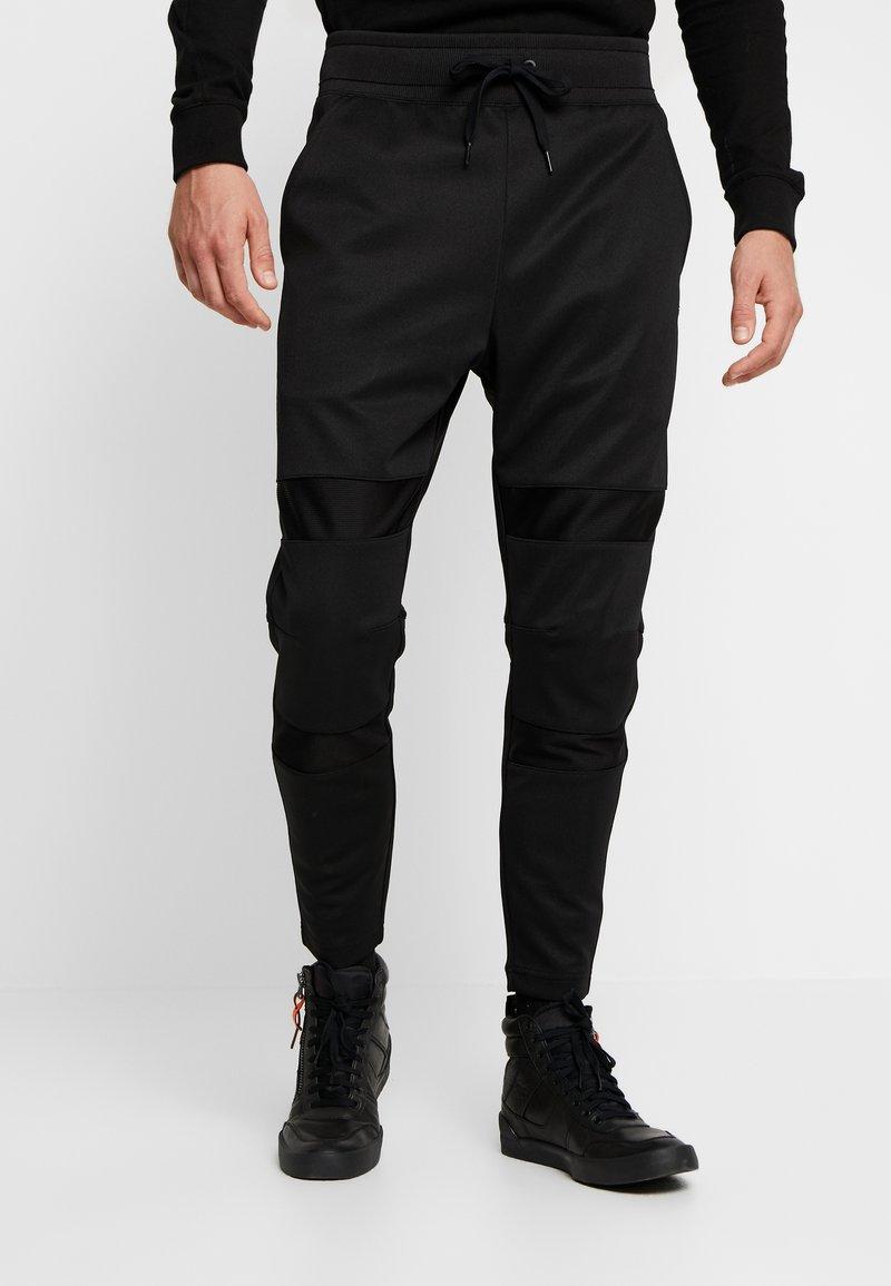 G-Star - MOTAC SLIM TAPERED SW PANT - Teplákové kalhoty -  black