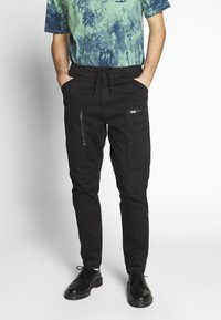 G-Star - POWEL SLIM TRAINER - Cargo trousers - dk black - 0