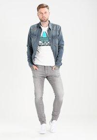 G-Star - 3301 DECONSTRUCTED SUPER SLIM - Jeans Skinny Fit - medium aged - 1