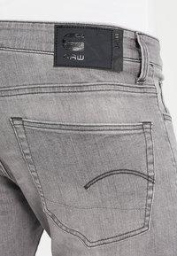G-Star - 3301 DECONSTRUCTED SUPER SLIM - Jeans Skinny Fit - medium aged - 4