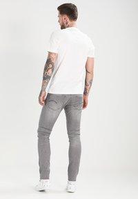 G-Star - 3301 DECONSTRUCTED SUPER SLIM - Jeans Skinny Fit - medium aged - 2
