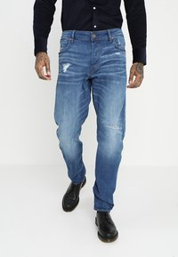 G-Star - ARC 3D RELAXED TAPERED - Relaxed fit jeans - rode stretch bright denim - medium aged ripped - 0