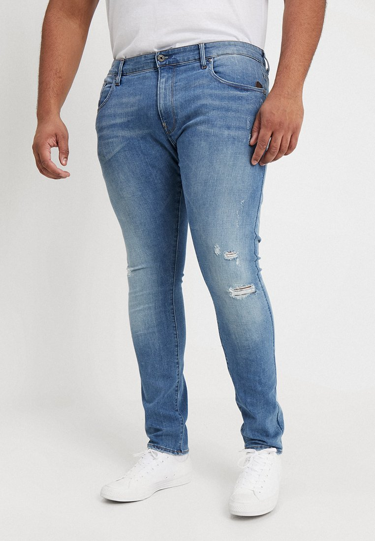 G-Star - REVEND SKINNY - Jeans Skinny Fit - trender ultimate stretch denim - medium aged destroy