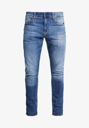 REVEND SKINNY - Slim fit -farkut - elto superstretch medium indigo aged
