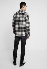 G-Star - REVEND SKINNY - Jeans Slim Fit - black denim - 2