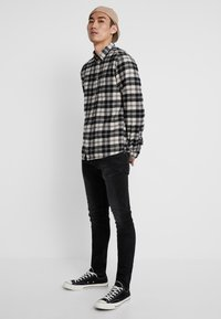 G-Star - REVEND SKINNY - Jeans Slim Fit - black denim - 1