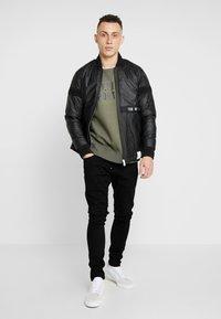 G-Star - REVEND SKINNY FIT - Jeans Skinny Fit - nero black - 1