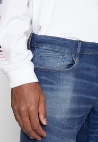 G-Star - 3301 STRAIGHT TAPERED - Jeansy Straight Leg - worker blue faded - 3