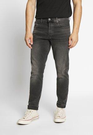 STRAIGHT TAPERED - Straight leg jeans - black denim