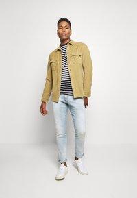 G-Star - REVEND SKINNY - Slim fit jeans - light blue denim - 1