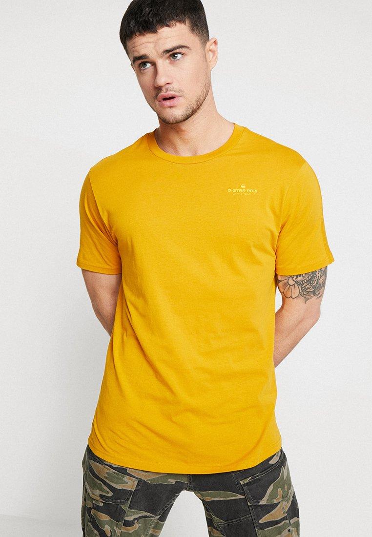 G-Star - KORPAZ GRAPHIC R T S\S - T-shirt print - gold