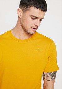 G-Star - KORPAZ GRAPHIC R T S\S - T-shirt print - gold - 3