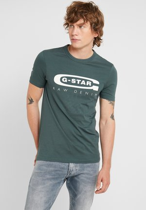 GRAPHIC SLIM - T-shirt med print - balsam