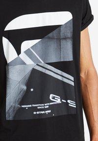 G-Star - SHELO RELAXED R T S/S - Camiseta estampada - dark black - 4