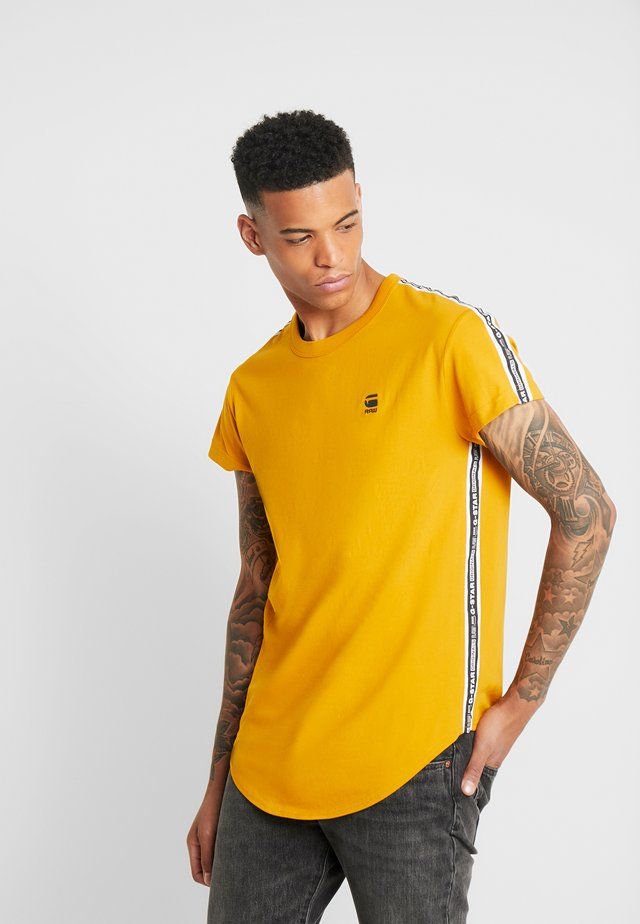 SWANDO ART RELAXED - T-shirt con stampa - gold