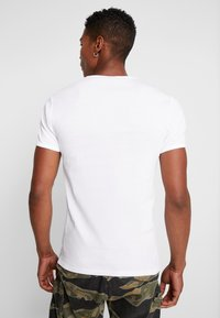 G-Star - BASE R T S/S - Jednoduché triko - white/black - 2