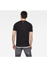 G-Star - VERTICAL RAW GR SLIM R T S\S DK BLACK MEN - T-shirt print - dk black - 1