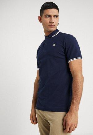 DUNDA SLIM STRIPE - Polo shirt - sartho blue/milk