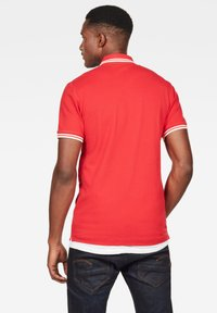 G-Star - DUNDA SLIM STRIPE - Polo shirt - flame/milk - 1