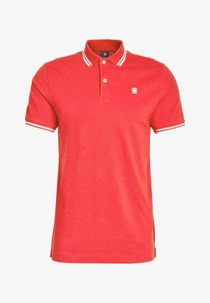 DUNDA SLIM STRIPE - Polo shirt - flame/milk