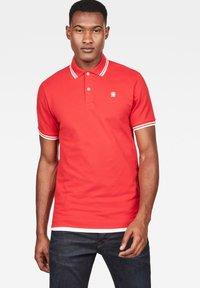 G-Star - DUNDA SLIM STRIPE - Polo shirt - flame/milk - 0