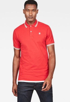 DUNDA SLIM STRIPE - Polo shirt - flame/milk