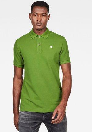 DUNDA SLIM - Polo shirt - green