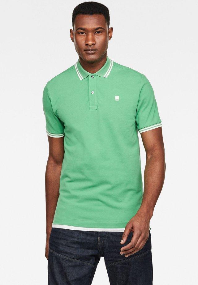 DUNDA - Polo shirt - lt leaf