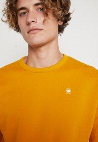 G-Star - KORPAZ  - Sweatshirt - dk gold - 4