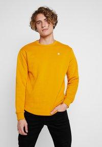 G-Star - KORPAZ  - Sweatshirt - dk gold - 0