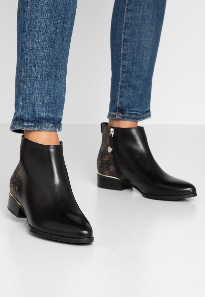 Guess - VERNETA - Ankle Boot - black/brass