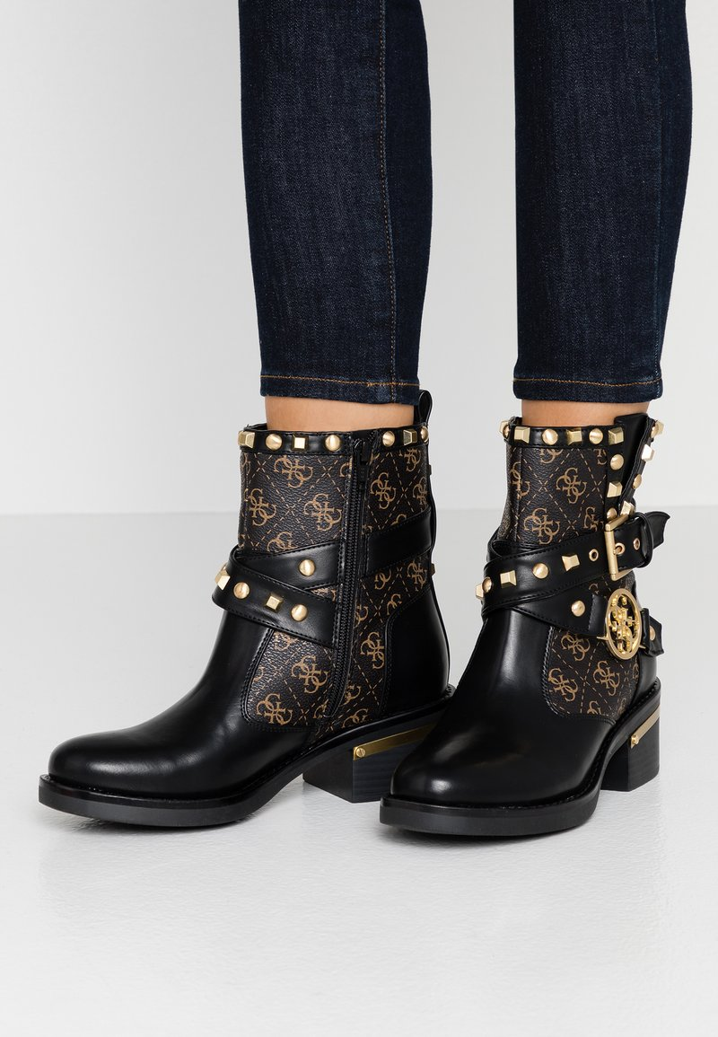 Guess - FENIX - Cowboy/biker ankle boot - black/brass
