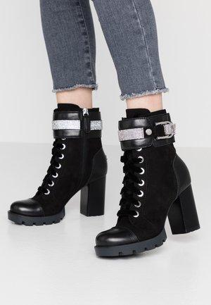 RADELLA - Platform ankle boots - black