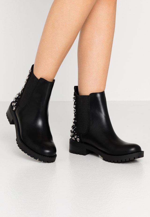 HURLIE - Korte laarzen - black