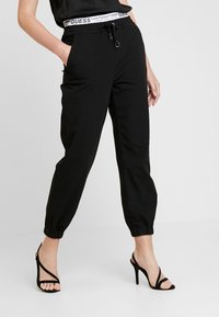 Guess - CORINNE JOGGER TAPE - Trainingsbroek - sporty black - 0