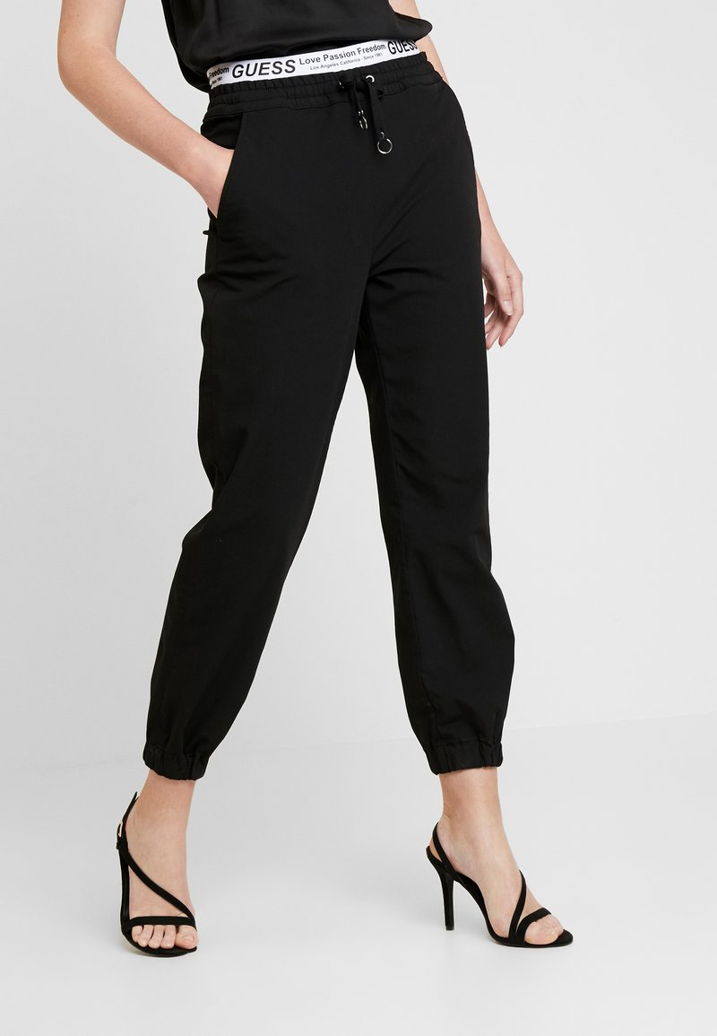 Guess - CORINNE JOGGER TAPE - Trainingsbroek - sporty black
