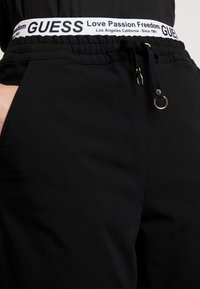 Guess - CORINNE JOGGER TAPE - Trainingsbroek - sporty black - 4